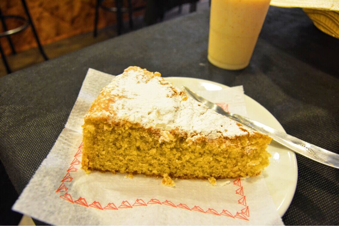 A photo of almond cake and milk found in Valldemoosa, Spain