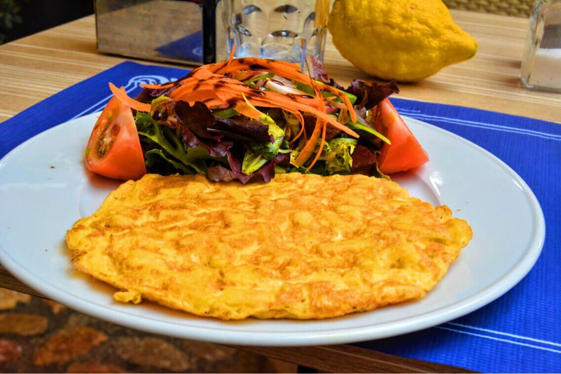 A spanish omelete with lots of vegetable