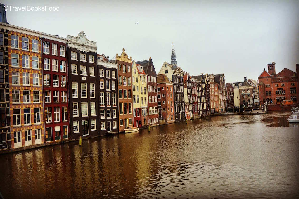 This is a photo of a very famous spot in Amsterdam. Lots of famous Amsterdam canal houses in a row facing the canal