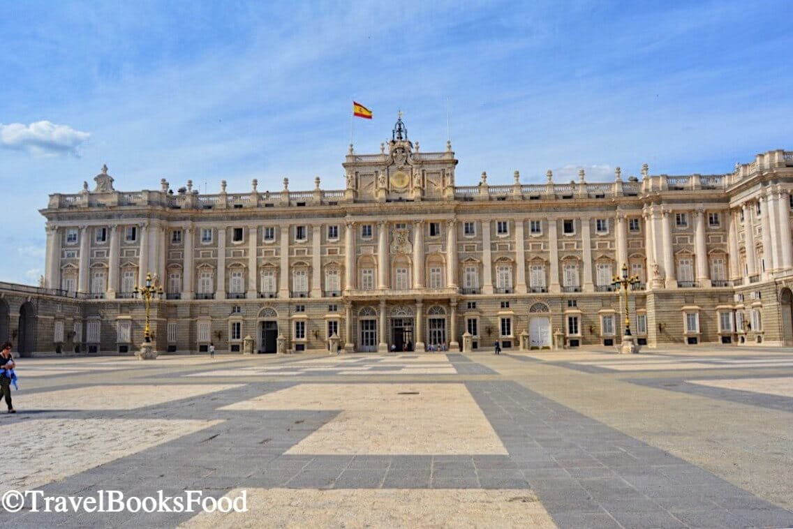Photo of the Royal Palace in Madrid. This is the largest palace in Europe by floor area. From outside it is a massive cream building.